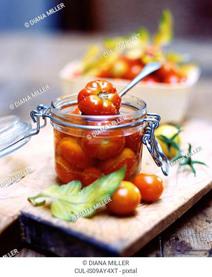 Heritage tomatoes in glass jar