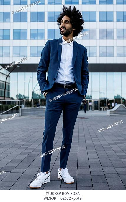 Spain, Barcelona, stylish young businessman standing in the city