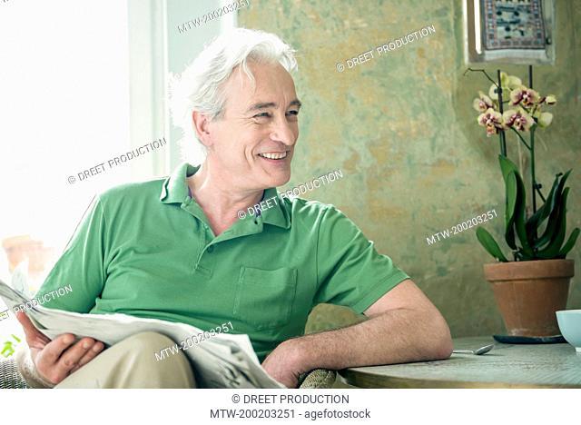 Mature man looking away, smiling