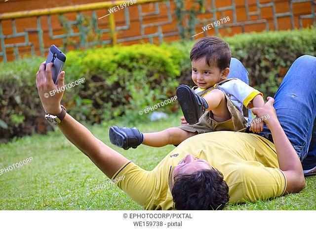 Cute Baby playing with dad, Pune, Maharashtra