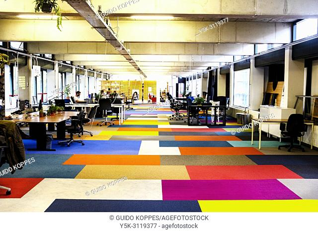 Amsterdam, Netherlands. Interior of De Cooperatie editorial office and workplace for freelancers and independent professionals