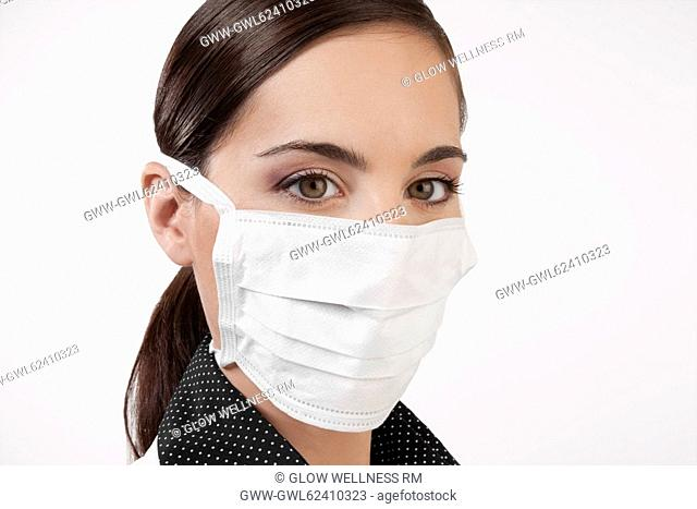 Female doctor wearing a flu mask