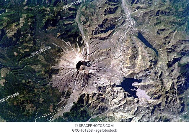 This spectacular, near-vertical photograph taken in September 1994 shows the 8360-foot 2548-meter Mount Saint Helens volcano with its developing lava dome and...