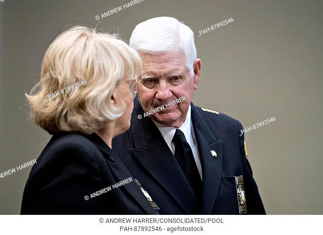 Harold Eavenson, sheriff from Rockwall County, Texas, right, talks to Carolyn Welsh, sheriff from Chester County, Pennsylvania
