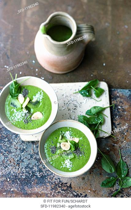 Green 'boost' smoothie bowls with shaved coconut