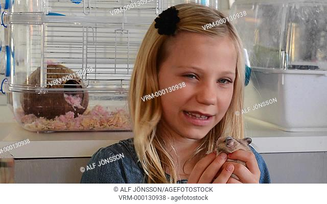 Girl with a hamster