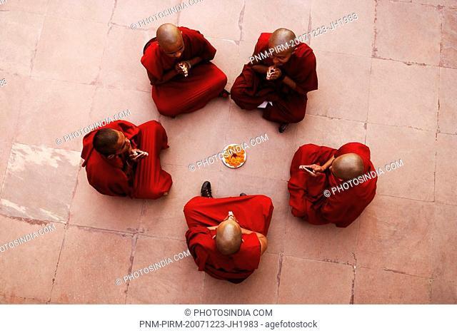 Monks sitting together and praying, Bodhgaya, Gaya, Bihar, India