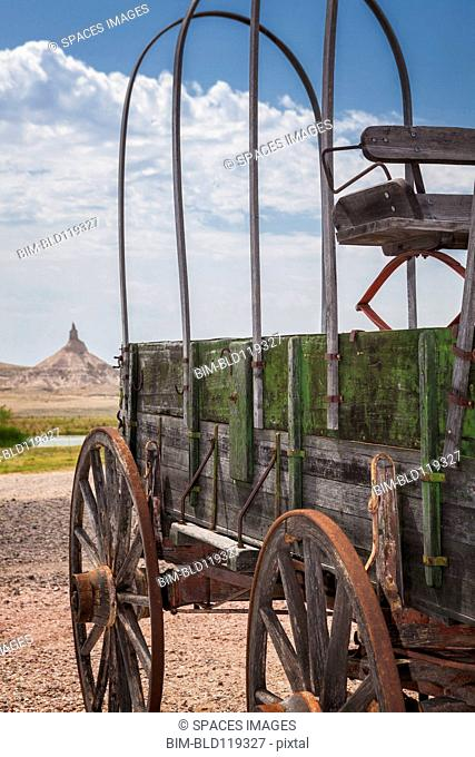 Wooden wagon and Chimney Rock, Nebraska, United States