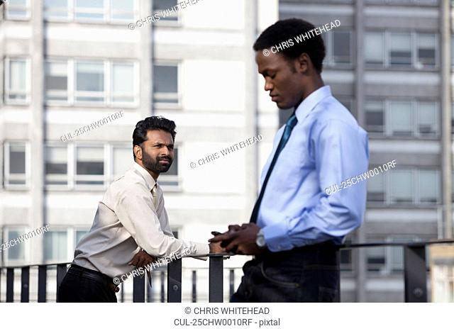 Two businessmen thinking before work
