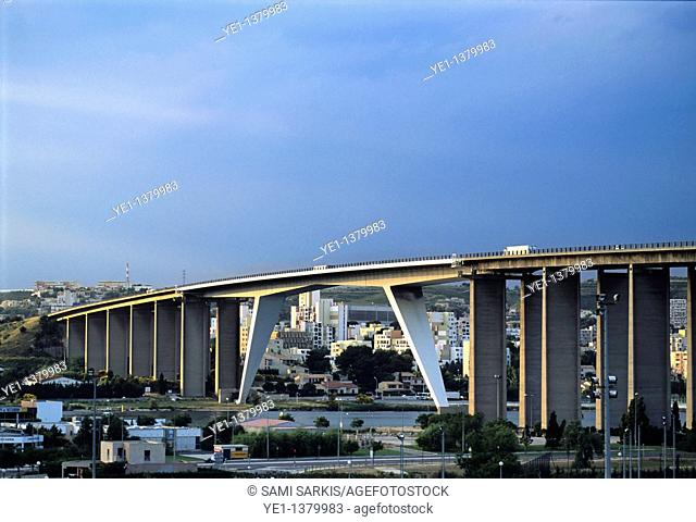 A55 highway bridge crossing through the town and river at sunset, Martigues, Provence, France