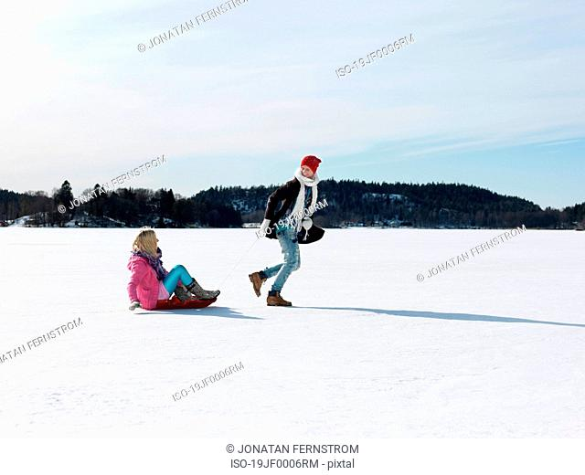 Couple with snow sledge