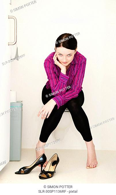 Woman relaxes in toilet
