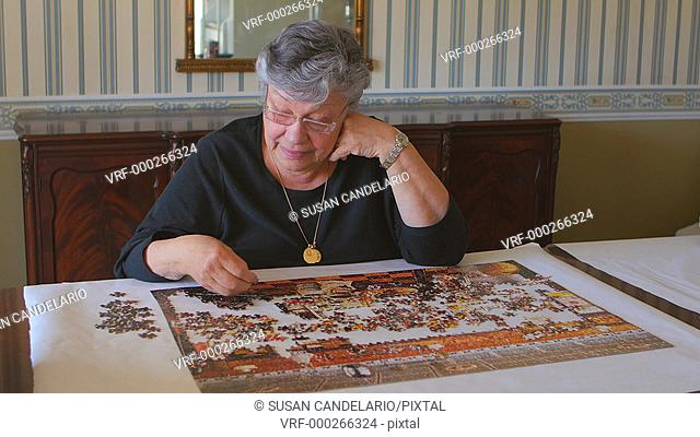 Mature woman and Jigsaw Puzzle