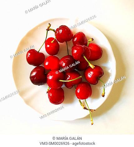 Wet cherries in a dish
