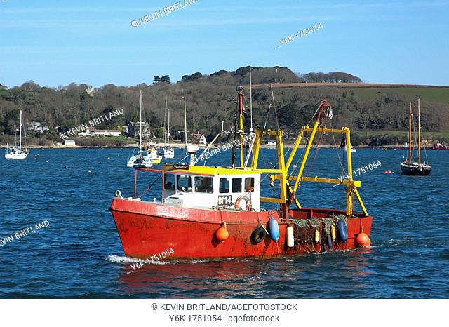 a fishing trawler returns to port at falmouth in cornwall, england, uk