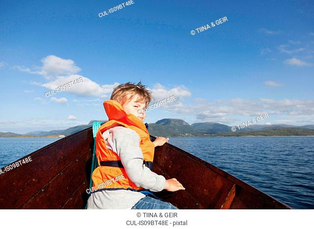 Boy looking back from front of rowing boat, Aure, More og Romsdal, Norway