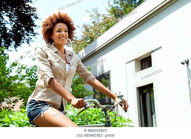 Woman riding bicycle, low angle