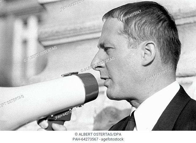 Lawyer Heinrich Hannover speaks during a megaphone after the pronouncement of judgement against Daniel Cohn-Bendit. To his right SDS chairman Karl-Dietrich...