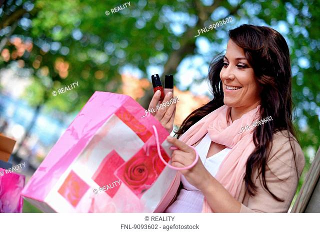 A woman is doing her shopping in the city