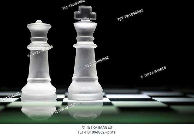 Chess queen and king on chess board