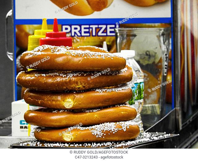 Pretzel. A type of baked bread product made from dough most commonly shaped into a twisted knot. Pretzels originated in Europe