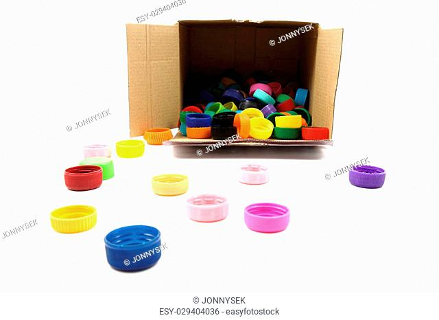 color plastic caps collection in the paper box