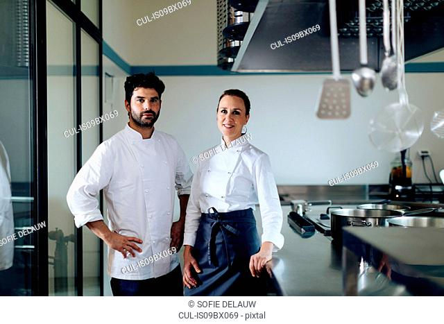 Portrait of chefs in kitchen