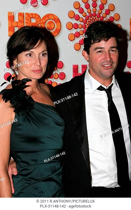 Kyle Chandler (r) and guest at the HBO's Post 63rd Annual Emmy Awards Party. Arrivals held in The Pacific at The Pacific Design Center in West Hollywood, CA