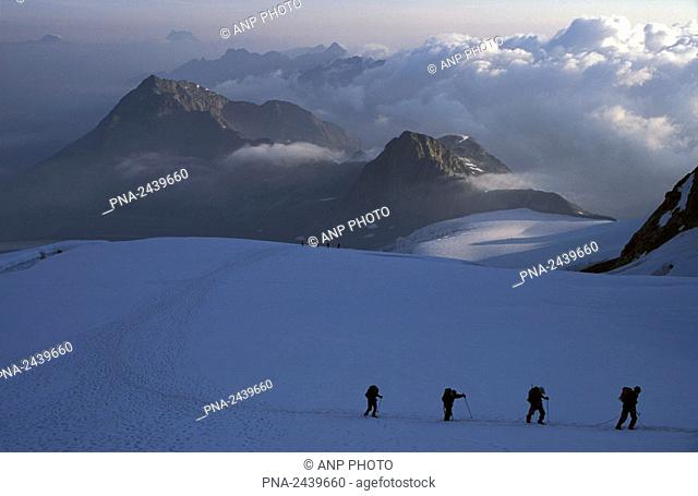 Mountain climbers during early morning on their way to the Piz Palu  Bernina-range  Switzerland