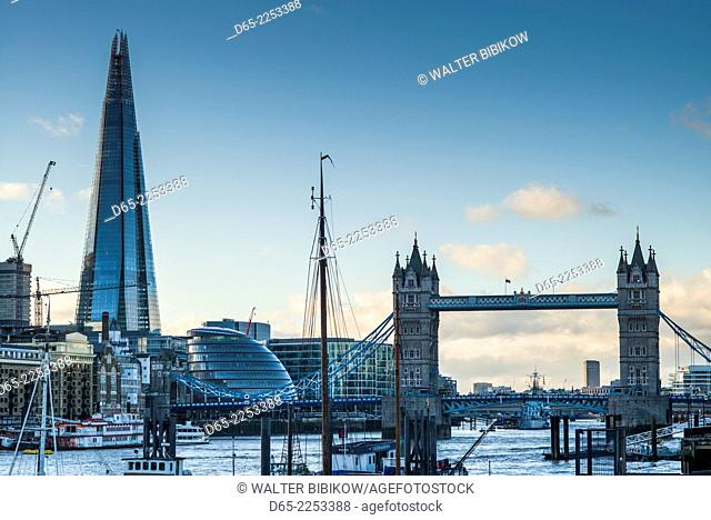 England, London, The Shard buildling and London Bridge from Shoreditch and the Thames River, dusk