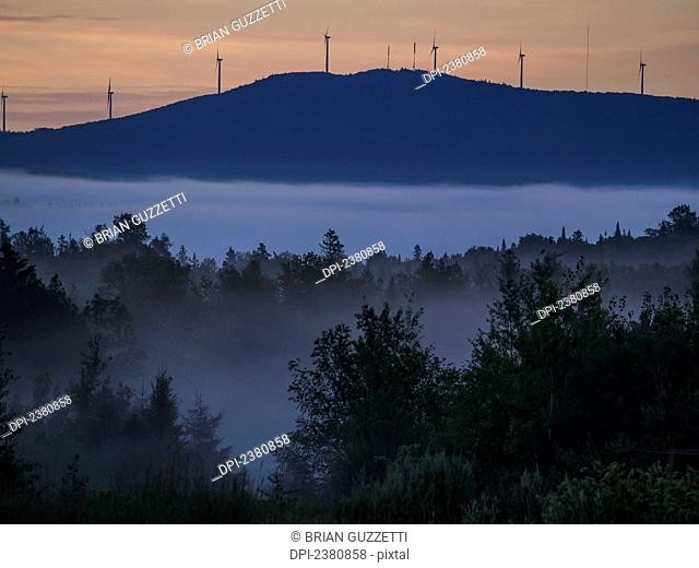 Sunrise lights the sky over Mars Hill, a mountain near Presque Isle; Maine, United States of America
