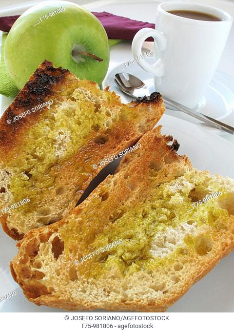 Toast with olive oil, coffee and apple