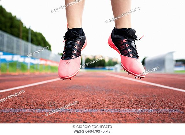 Feet of a jumping runner, mid air