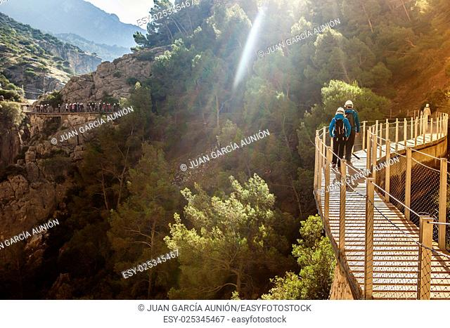 Visitors walking along the footbridge of Caminito del Rey path, Malaga, Spain