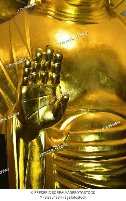 Golden Buddha statue detail in Fukuoka, Japan, Asia