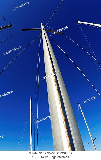 Sailboats masts at port against blue sky, Marseille, France