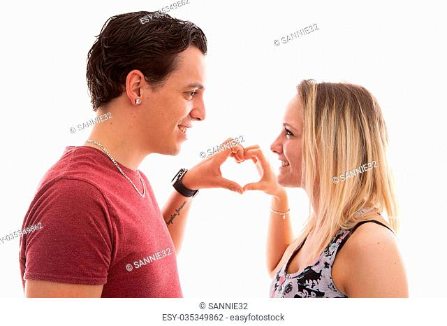 Young couple in lovemaking heart with hands over white background