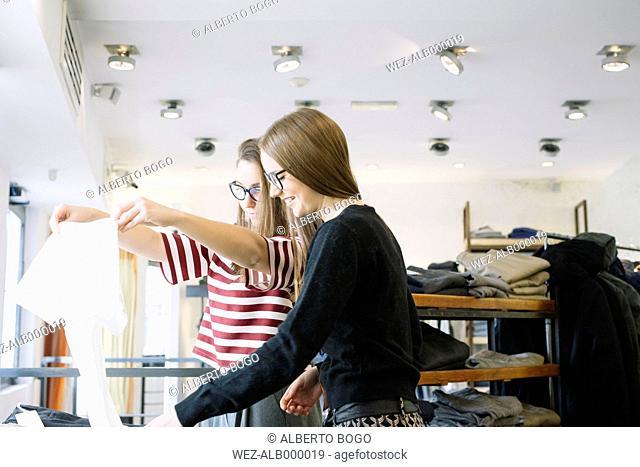 Two young women in a fashion shop
