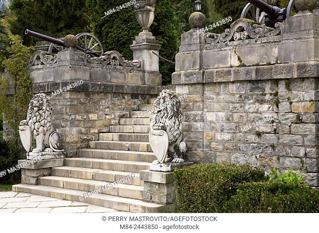 The heraldic lion marble sculptures in front of the Peles Castle in autumn, Sinaia, Romania, Eastern Europe