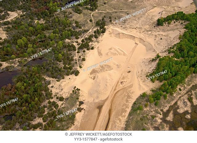 Aerial view of a sand mining operation near Lake Michigan and boarders on the Ludington Dunes State Park in Michigan, USA