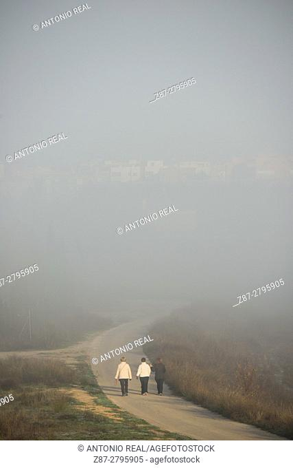 People walking and fog, Almansa, Albacete province, Castilla-La Mancha, Spain