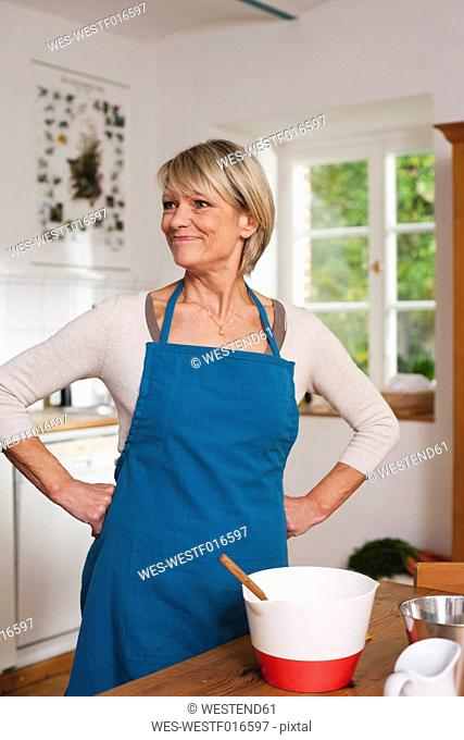 Germany, Kratzeburg, Senior woman preparing food