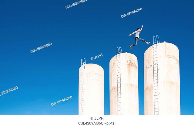 Man leaping across towers
