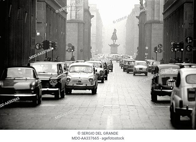 Via Roma in Turin is invaded by road traffic. A sight of Via Roma, in Turin, near Piazza San Carlo. Via Roma is invaded by cars; among them