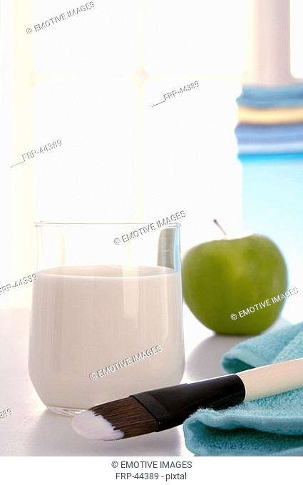 Facial mask with yoghurt, an apple and a brush