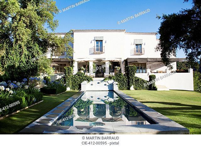 Luxury lap pool and Spanish villa