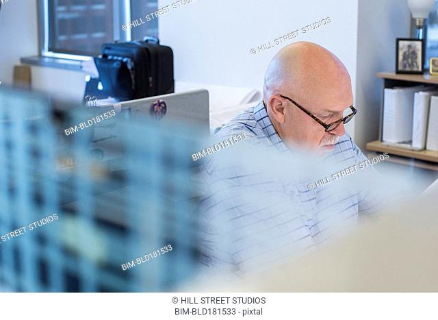 Businessman working in office cubicle
