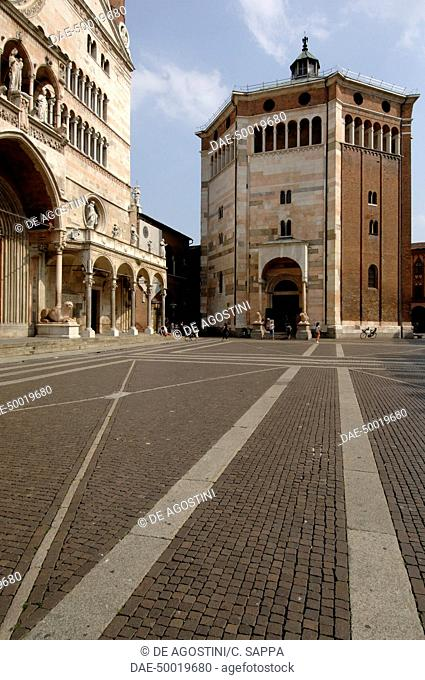 Cremona Baptistery (begun in 1167) in Piazza del Duomo, with the Cathedral porch on the left, Cremona, Italy