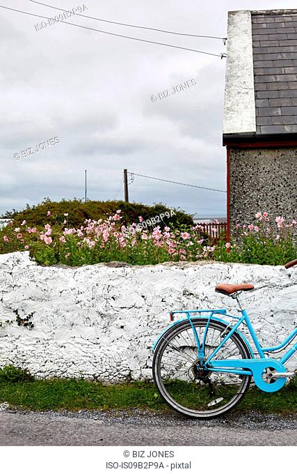 Bicycle beside wall, Inishmore, Ireland