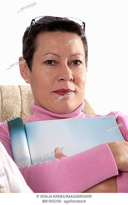 Woman sitting comfortably on sofa
